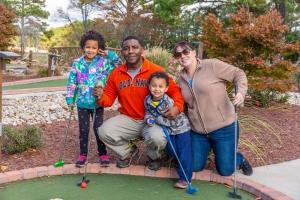 Happy Family at Mini Golf
